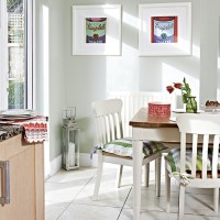 Bright and modern diner with white wood table