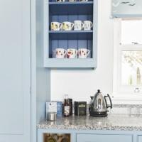 Blue Shaker-style kitchen with pretty storage