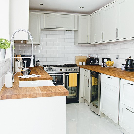 White kitchen with wooden worktops and metro tiles for Metro tiles kitchen ideas