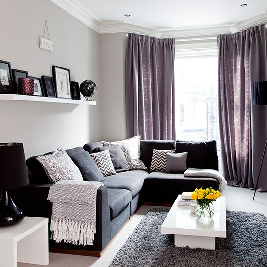 Grey traditional living room with purple soft furnishings Grey and purple living room