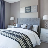 Grey traditional bedroom with upholstered button-back headboard