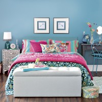 Blue bedroom with hot pink accents and blanket box