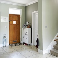 Traditional hallway with soft-green walls and storage unit