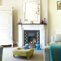 Pastel living room with blue and green furnishings
