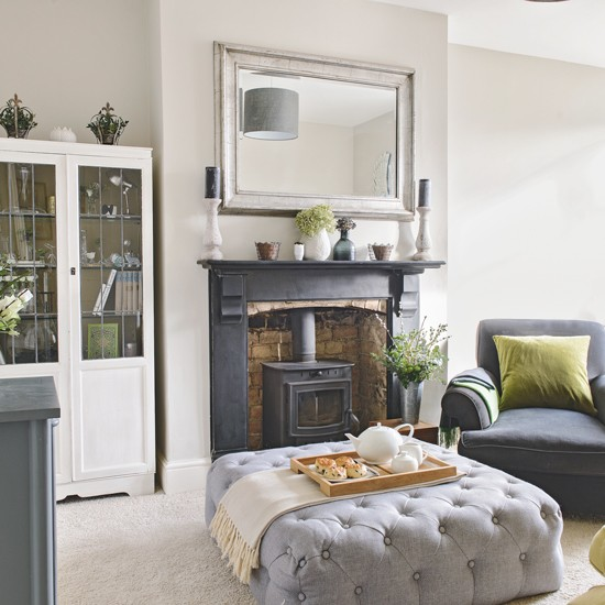 White Living Room With Traditional Black Fireplace