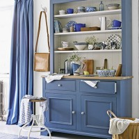 Dining area with handsome blue dresser and curtains