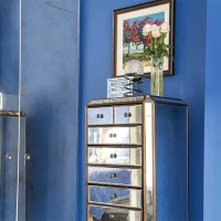 Sapphire blue bedroom with sparkling mirrored tallboy