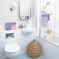 White traditional bathroom with blue tiled floor and colourful accessories