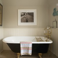 Classic cottage bathroom with wood panelling