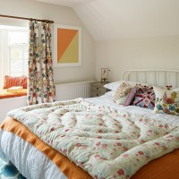 Eaves bedroom with country-style bedding