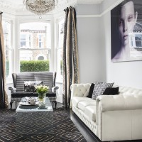Glamorous living room in black and white with a touch of gold