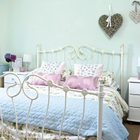 Pale blue bedroom with floral bedlinen