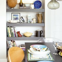 Dining room with smart grey alcove shelving