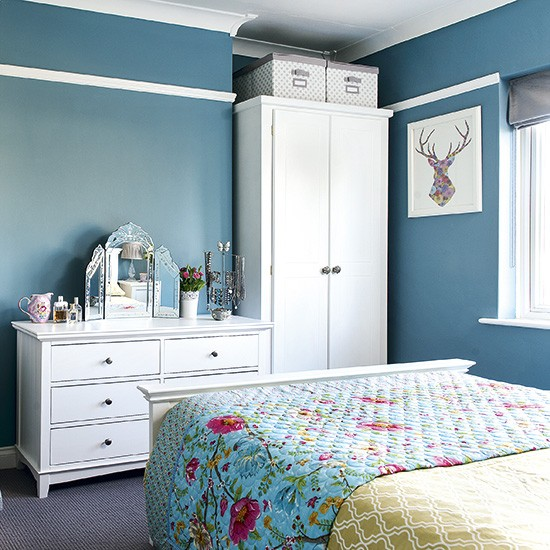 Deep Blue Bedroom With White Wood Storage Furniture