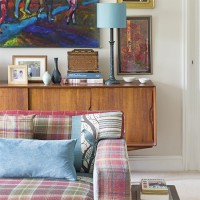 Retro living room with wooden sideboard and tartan sofa