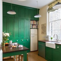 Traditional kitchen with green painted cabinetry