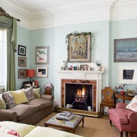 Traditional living room with ornate mantel and duck egg walls
