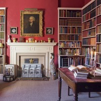 Traditional library with crimson walls and book storage