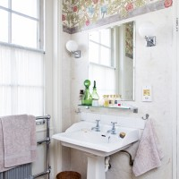 Bathroom with vintage wallpaper and traditional fittings and fixtures