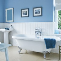 Blue traditional bathroom with white fittings and fixtures