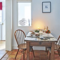 White traditional dining room with wooden furniture