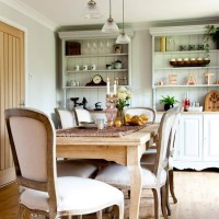 Country style dining space with painted dressers