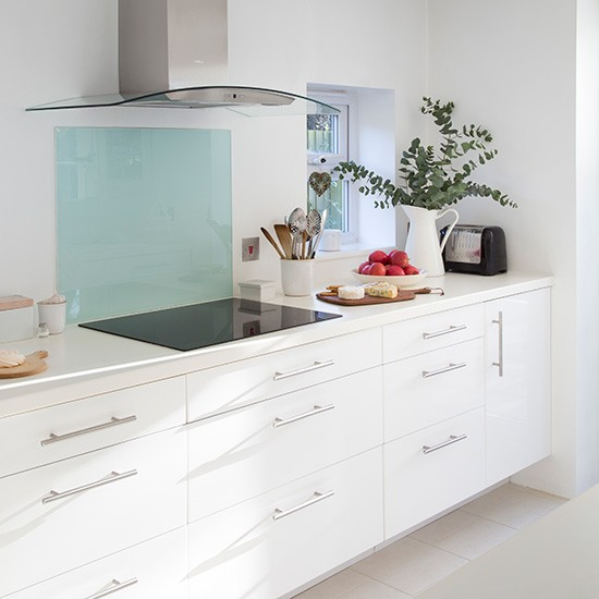 White Kitchen With Blue Glass Splashback