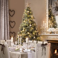 Neutral dining room with woodland and gold decorations