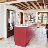 Be inspired by this country kitchen diner with red island unit