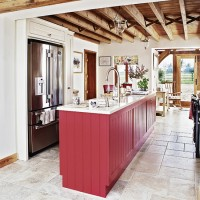 Cottage kitchen with beamed ceiling and red cabinetry