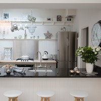 Modern white kitchen with open shelving and added Christmas sparkle