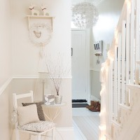 Whitewashed hallway decorated for Christmas