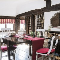Country dining room with exposed beams