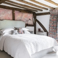 Country bedroom with exposed oak beams