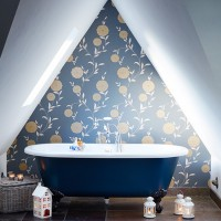 Country bathroom with blue roll top bath
