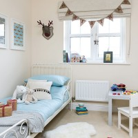 Neutral children's bedroom with blue bedding