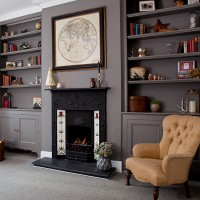 Grey traditional living room with fireplace and alcove shelving