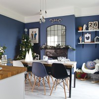 Blue modern dining room with Christmas decorations