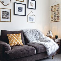 Neutral modern living room with faux-fur throw and wall display
