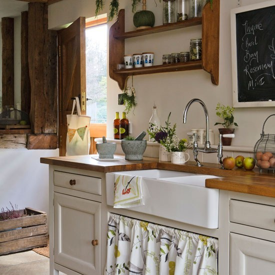 Rustic kitchen with wood worktops and open shelving