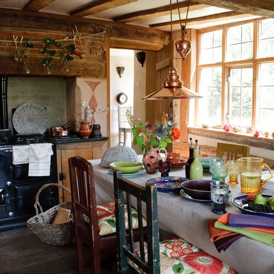 Rustic kitchen with feature table and mix-and-match chairs