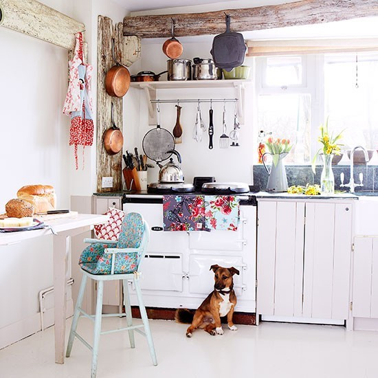 Rustic kitchen in all-white with freestanding units ...