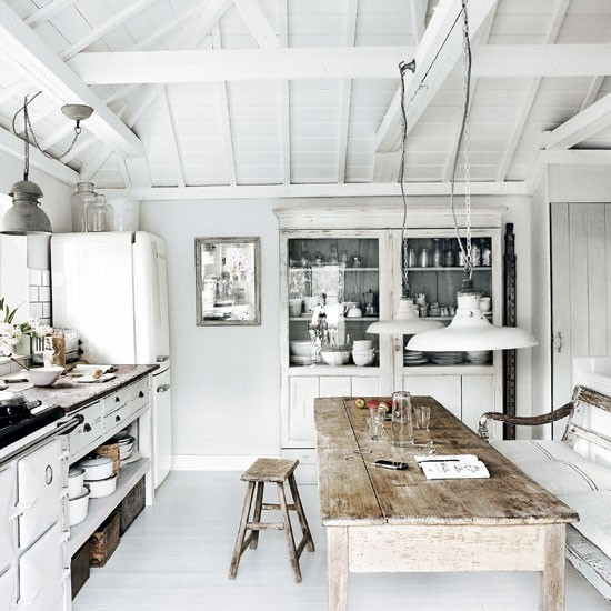 Rustic kitchen with blue Aga and impressive flagstone floor