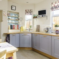 Neutral country kitchen with lilac cabinetry and patterned blinds