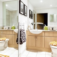 Bathroom with fitted storage and full-sized mirrors
