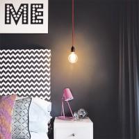 Charcoal grey bedroom with chevron headboard