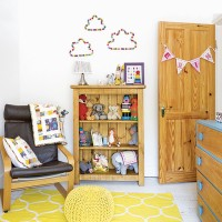 White and yellow children's bedroom with pom pom wall art