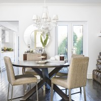 Modern dining room with white walls and darkwood floor