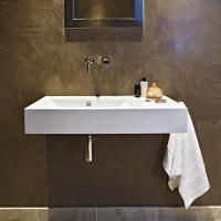 Modern bathroom with white sanitaryware and polished plaster wall