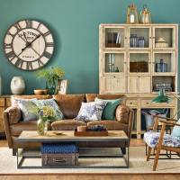 Forest green living room with wooden cabinet and leather sofa